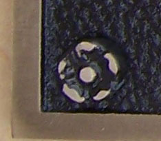 Rosette; used to cover screw head